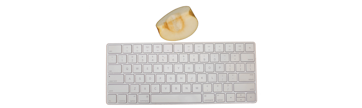 Image of Mac keyboard with a quarter of apple above it.